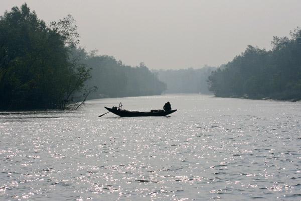 Logging boat in the Sundarbans. Photo by: Pranabesh Das.