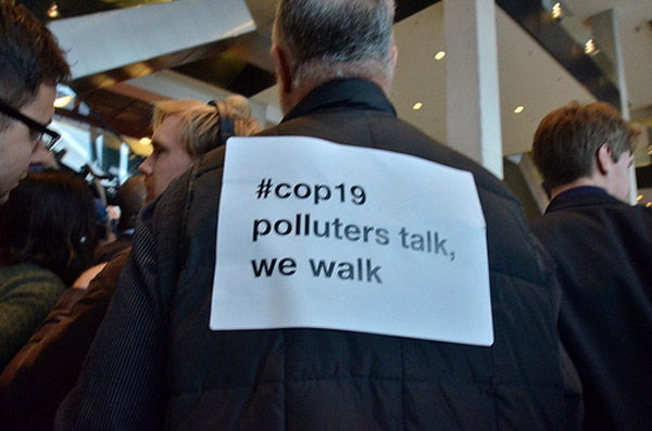 NGO members walking out of UN Climate Summit in Warsaw. Photo by: © Nitin Sethi.