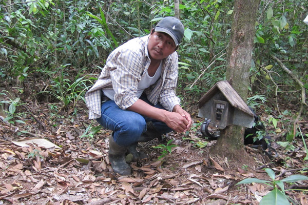 Field assistant setting camera trap. Photo by: Christopher Jordan.