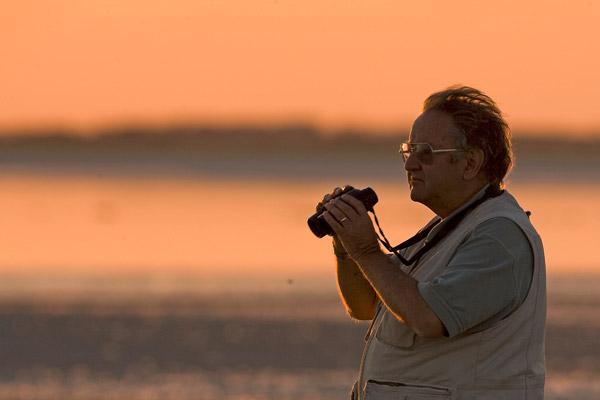 Stuart Pimm birding at sunset. Photo courtesy of Stuart Pimm.