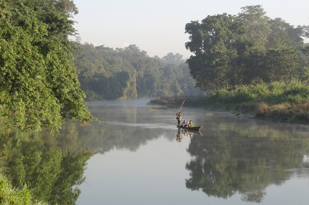 Canoeing is a popular way to see Chitwan. Photo by: Grzegorz Mikusinski.