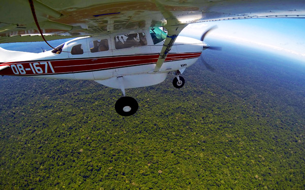 Flying over the endless forest of the West Amazon, while searching for short-eared dogs. From so high up it was possible to see just how much forest there really is, and how much there is still to save. Photo courtesy of: Paul Rosolie.