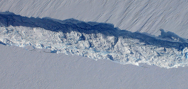 A massive crack discovered on Pine Island Glacier in Western Antarctica which scientists now say is headed toward irreversible disintegration. The crack, discovered by an overflight in 2011, will eventually release a massive iceberg. Photo by: NASA.