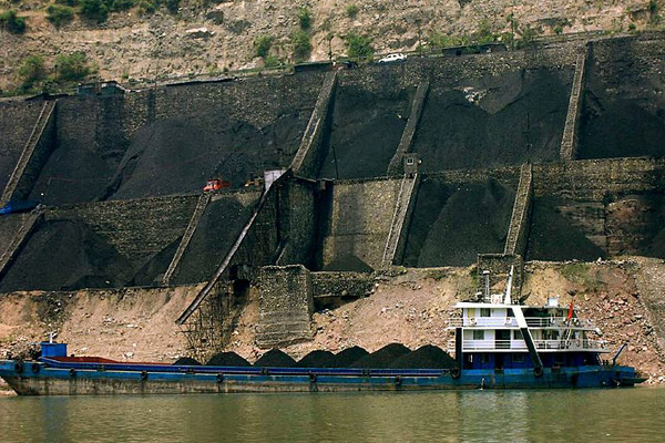 Coal hopper with barge in China. The country is the largest consumer of coal, which is the most carbon-intensive energy source. Photo by: Rob Loftis.