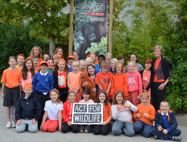 School children celebrate Go Orange for Orangutans. Photo by: Chester Zoo.