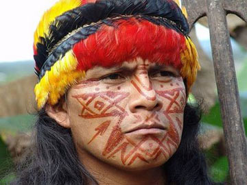 A Shuar man in traditional dress.