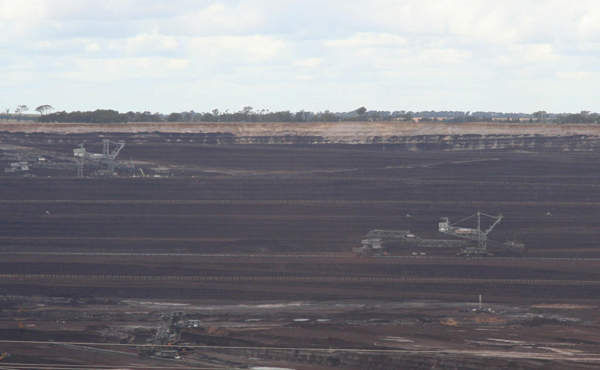 Massive coal mine in Australia for the Loy Yang Power Station. Coal is the world's most carbon intensive fuel source and scientists say much of it must be left unexploited to avoid catastrophic, global impacts. Yet, governments, such as Australia, continue to whole-heartedly support the coal industry. Photo by: Marcus Wong Wongm.
