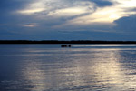 Boat on the Amazon River at sunset