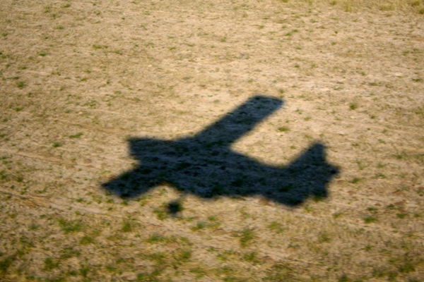 Shadow of airplane flying over the Okavango delta