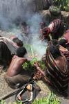 Tribal Dani women cooking sweet potato [papua_0604]