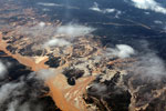 Airplane view of the Río Huaypetue gold mine in the Amazon rainforest