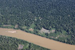 Aerial view of deforestation along a river in Peru's southeastern Amazon region