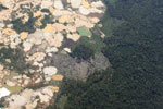 Aerial view of Amazon landscape scarred by open pit gold mining