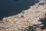 Aircraft view of Amazon rainforest landscape scarred by open pit gold mines