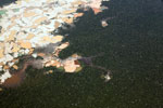 Plane view of Amazon landscape scarred by open pit gold mines