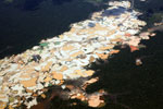 Plane view of Amazon rainforest landscape scarred by open pit gold mining