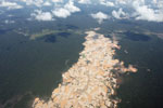 Overview view of Amazon rainforest landscape scarred by open pit gold mines