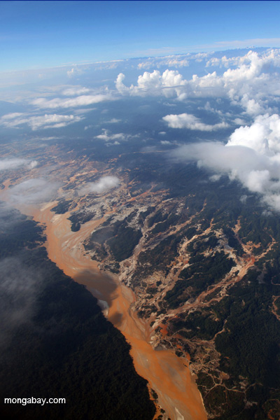 Gold mining is another major source of mercury pollution. This is an aerial view of the  Río Huaypetue gold mine in Peru, one of the largest in the world. Photo by: Rhett A. Butler.