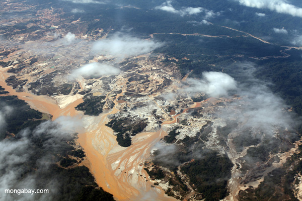 Aerial view of the Río Huaypetue gold mine in Peru. The mine, which was cut of the Amazon rainforest, has been blamed for large-scale environmental damage and social problems, including allegations of child labor. Photo by: Rhett A. Butler.