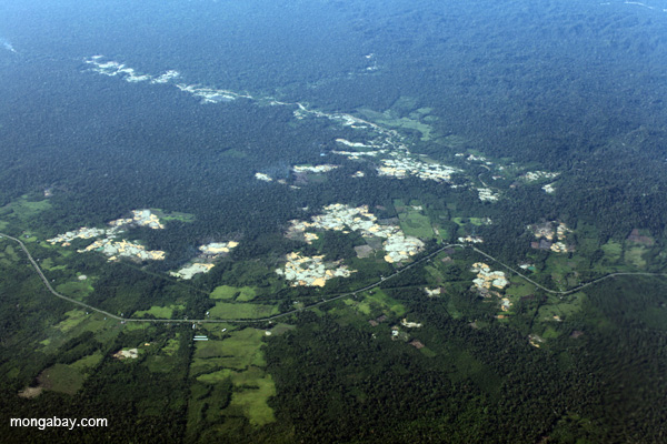 Aerial view of deforestation stemming from the controversial TransOceanic highway in the Peruvian Amazon. The major highway cuts through the rainforest in Brazil and Peru. Photo by: Rhett A. Butler.