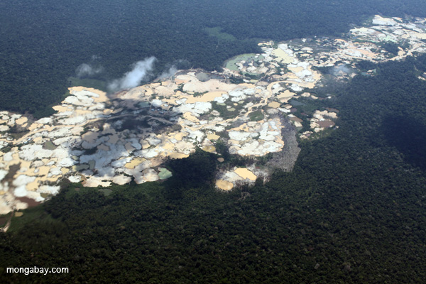 Aerial view of open pit gold mining in the Madre de Dios region, a practice that puts both people and wildlife at risk in addition to destroying huge areas of rainforest. Photo by: Rhett A. Butler.
