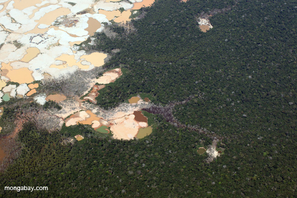 Aerial view of Amazon rainforest landscape scarred by open pit gold mining. Photo by: Rhett A. Butler.