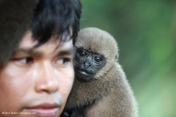 Amerindian man with a woolly monkey