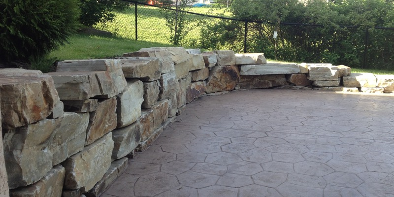 small rock wall with concrete slab