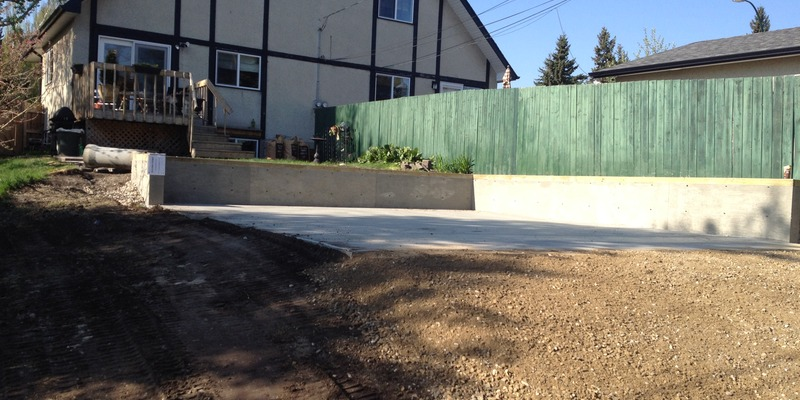garage pad with retaining wall