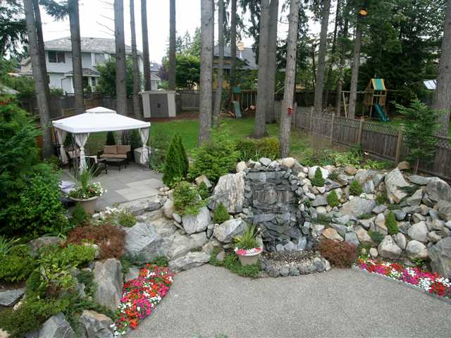 Exterior Back with Gazebo sitting area & Rock featured Water fall