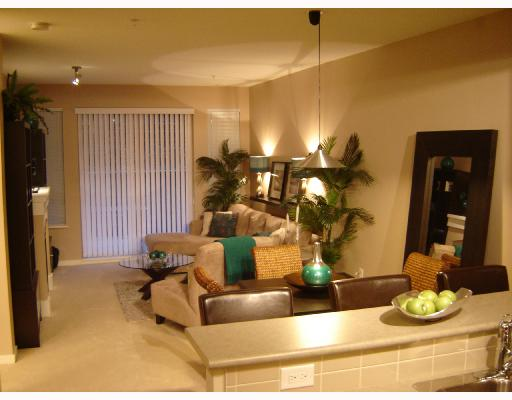 "Photo 1: 117 2969 WHISPER Way in Coquitlam: Westwood Plateau Condo for sale in ""SUMMERLIN"" : MLS(r) # V695993"