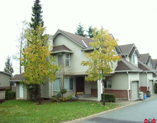 "Main Photo: 410 13900 HYLAND Road in Surrey: East Newton Townhouse for sale in ""HYLAND GROVE"" : MLS®# F2927615"