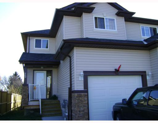 Main Photo: 15 Parklane Drive: Strathmore Residential Attached for sale : MLS® # C3376415