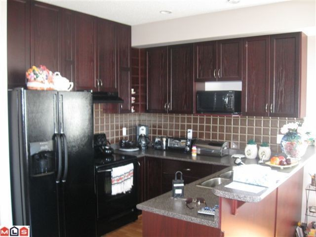 "Photo 2: 116 33751 7TH Avenue in Mission: Mission BC Townhouse for sale in ""HERITAGE PARK"" : MLS® # F1019203"