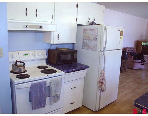 "Photo 3: 2077 WARE Street in Abbotsford: Central Abbotsford House Duplex for sale in ""ABBOTSFORD HOSPITAL"" : MLS® # F2914596"