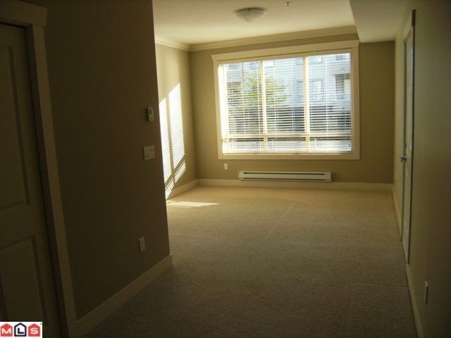 "Photo 4: 205 15368 17A Avenue in Surrey: King George Corridor Condo for sale in ""Ocean Wynde"" (South Surrey White Rock)  : MLS® # F1100152"