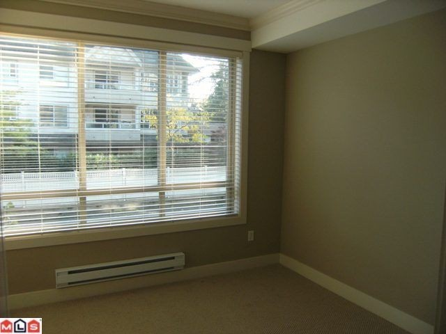"Photo 5: 205 15368 17A Avenue in Surrey: King George Corridor Condo for sale in ""Ocean Wynde"" (South Surrey White Rock)  : MLS® # F1100152"