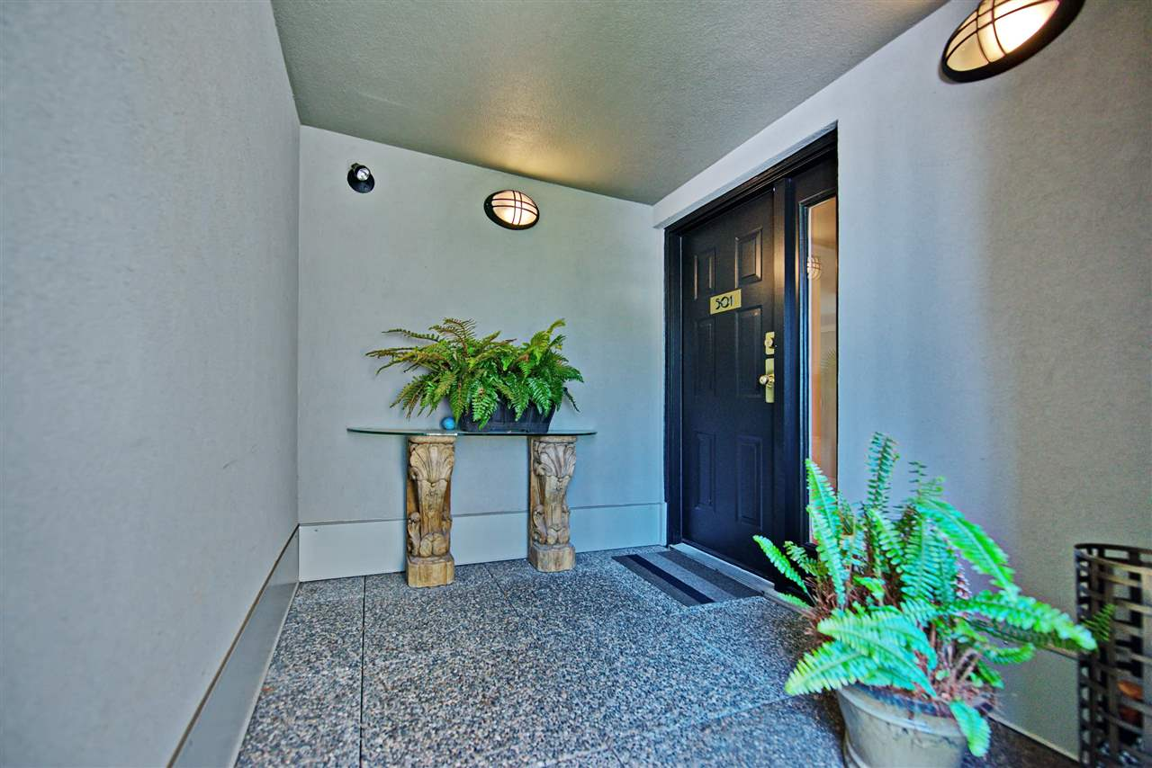 Open air hallways and a porch area outside your door give this property a private, townhouse feel