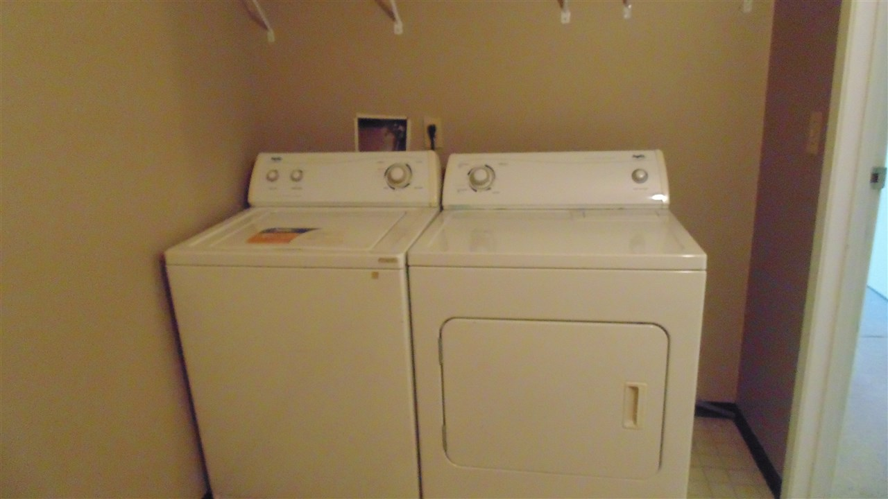 Real Laundry room with full sized washer and dryer