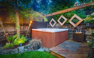 Cozy hot tub nestled in the backyard.