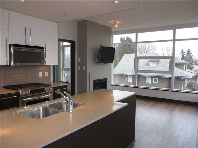 "Photo 3: 404 1088 W 14TH Avenue in Vancouver: Fairview VW Condo for sale in ""COCO"" (Vancouver West)  : MLS(r) # V1044068"
