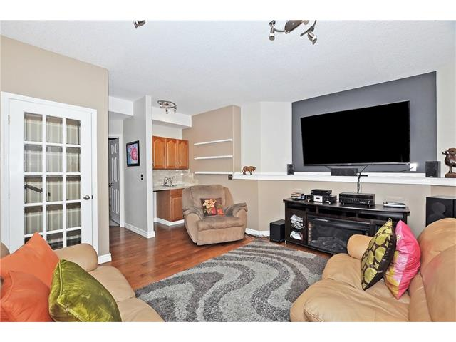 Lower level family room with a walk up wet bar