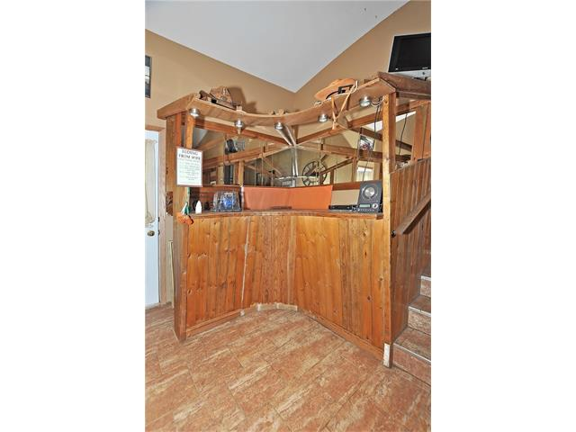Mudroom off the garage...this is an older built-in bar that could be replaced with lockers for storage
