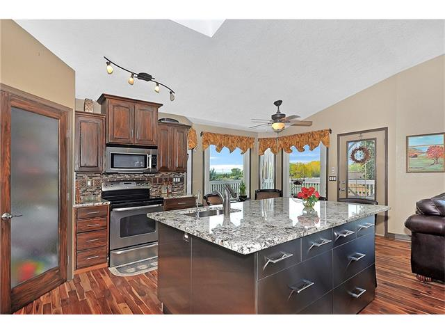 Granite, stainless steel appliances and a corner pantry
