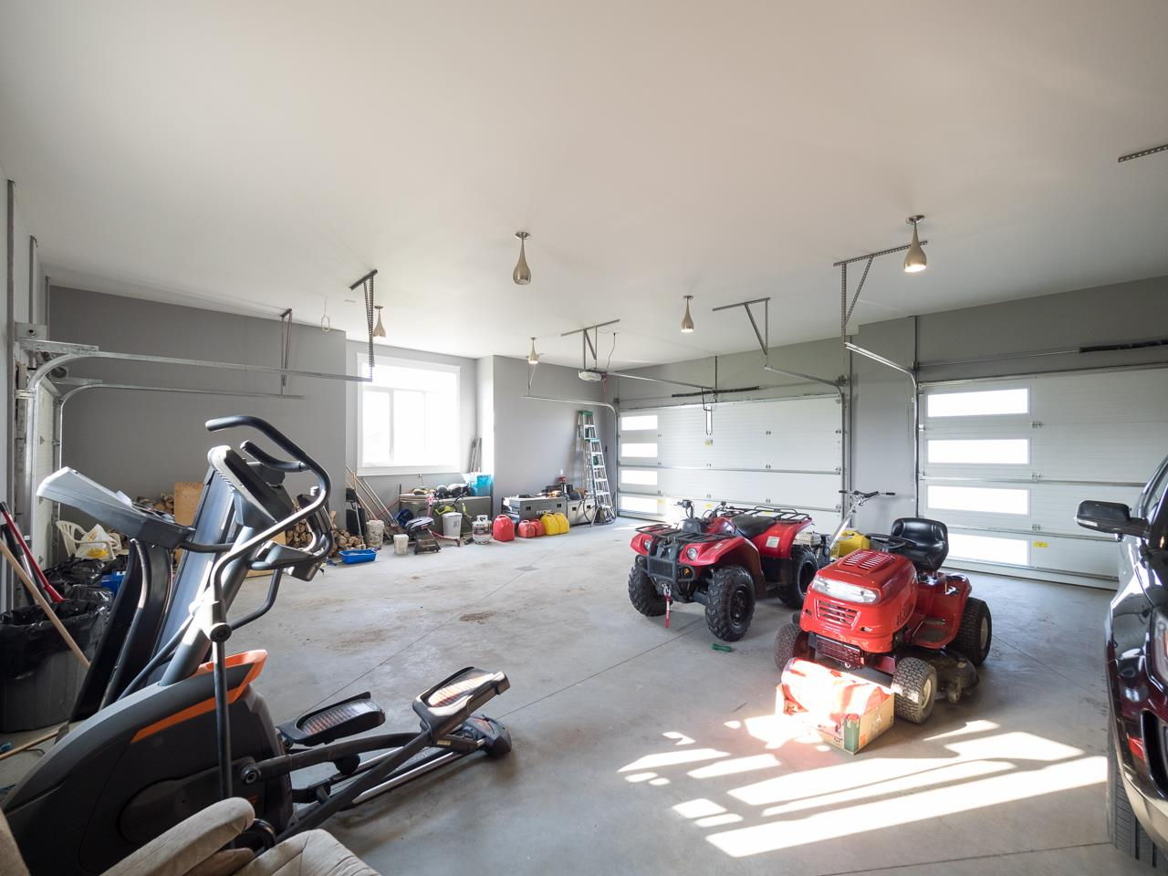 Huge 4 car garage, heated and insulated with 220 V power.