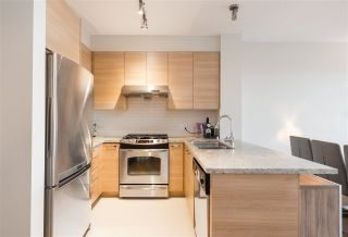 "Main Photo: 410 9388 MCKIM Way in Richmond: West Cambie Condo for sale in ""MAYFAIR PLACE"" : MLS® # R2249986"