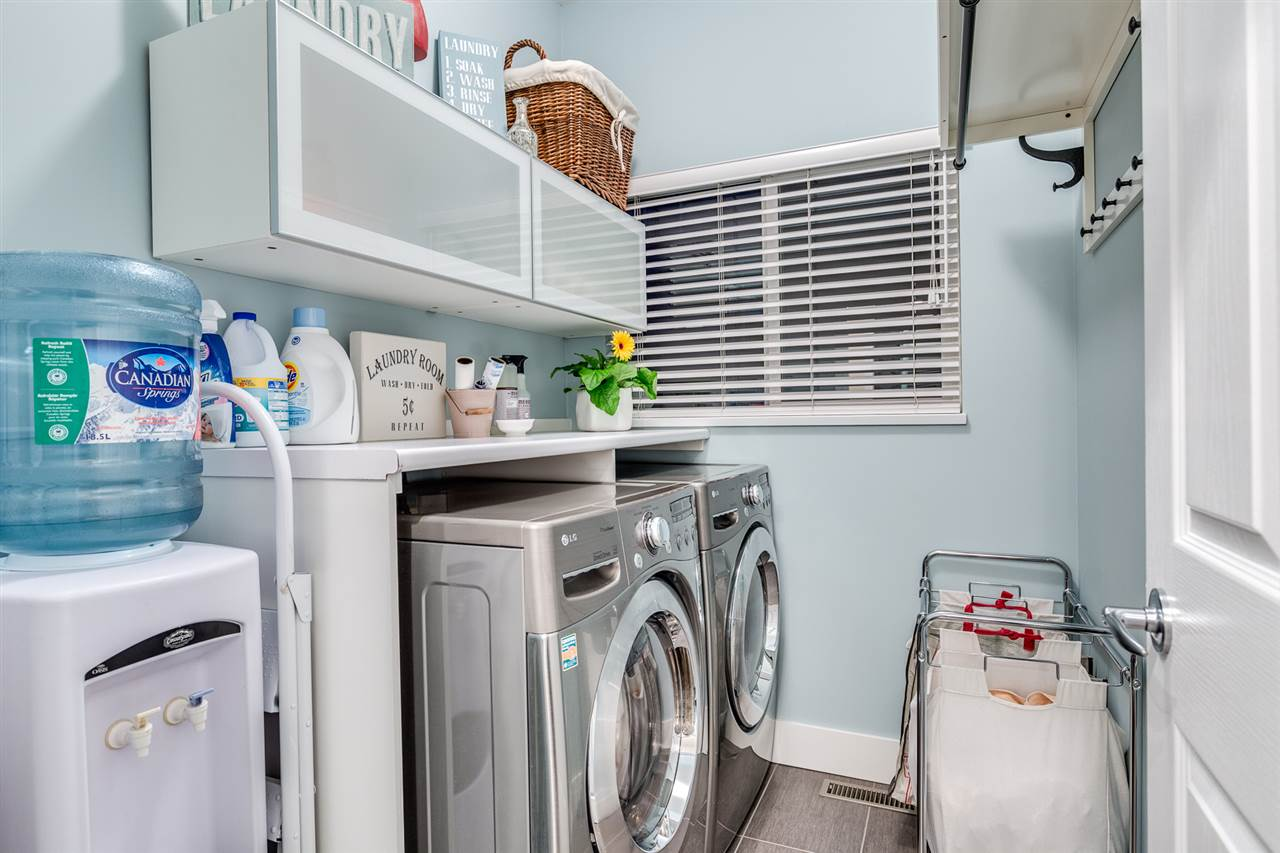 Spacious laundry room with overhead storage