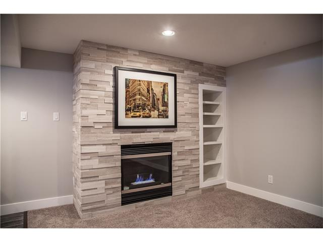 Limestone gas fireplace and built in shelving