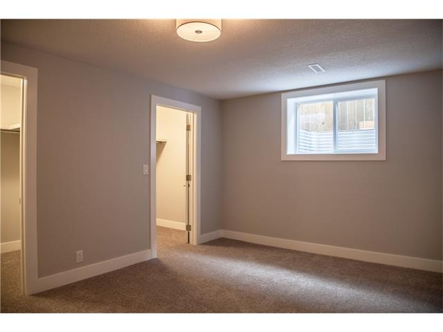 Large window and double closets in lower 4th bedroom