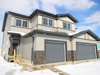 Main Photo: 20754 99A Avenue in Edmonton: Zone 58 House Half Duplex for sale : MLS(r) # E4054756